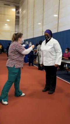 Denise Yon and Carolyn Winbush talk before their vaccination clinic shifts